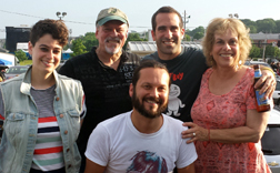 The family — Jerry (top row, second from right) and Mimi Goodman (far right), with their son Jesse (left of Mimi) and daughter Sara (far left) and Jesse's partner Max Oliva (front)